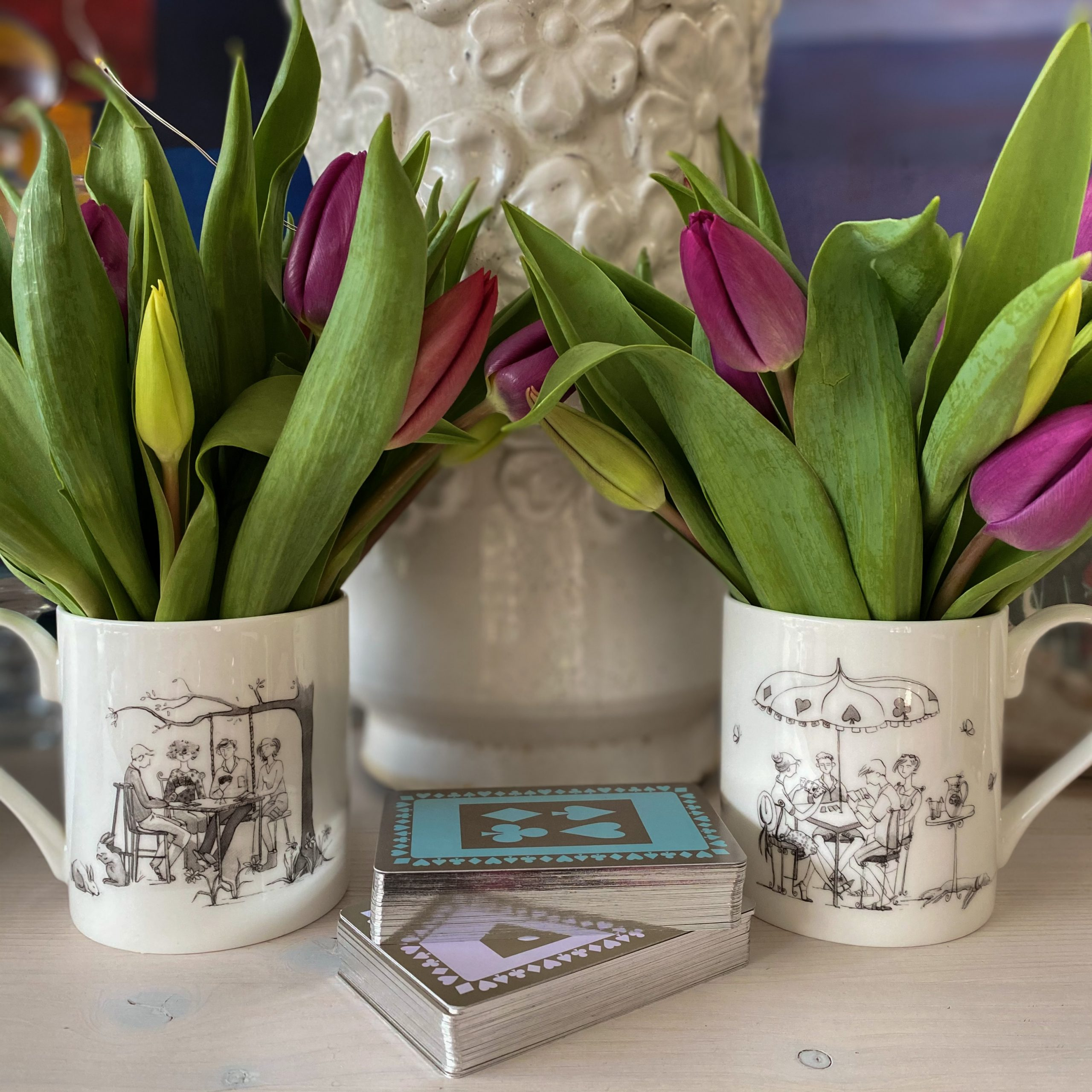 Bridge in the Box profile picture with tulips and mug and playing cards